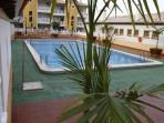 Communal swimming pool with a shallow end, being close to the Apartment ideal place to relax & e