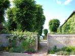 Beautiful grounds include this sunny  walled garden