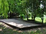 Petanque in the shade of a willow tree