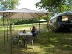 Outside living with bbq and dining French style,overlooking the lake with a glass of wine