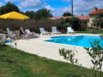 Pool set slightly apart from the gites - in the sun all day