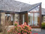 Mungos Well has a private south facing conservatory with views over cottage garden to Cheviot hills.