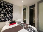 Bedroom 2. Luxurious pillow top queen bed and small ensuite with toilet and basin