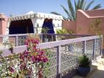 Colourful roof garden with Berber tent.