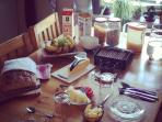 Delicious breakfast with homemade bread and jams and local specialities