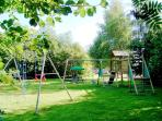 Childrens Play-area with swings, climbing frame, slide, sandpit etc.