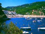 Walk on scenic coastal path from villa to this fishing village