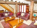 Comfortable lounge, cool and airy in summer, warm and toasty in the winter, with a cosy log fire