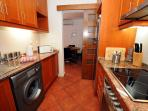Well equipped galley kitchen with washing machine and all the equipment you will need
