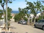 Street leading from house to El Carmoli beach