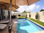 Private enclosed courtyard with heated pool and grill. This is living!