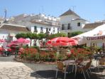 Estepona Town with beautiful cobbled streets and orange filled squares with large shopping area.