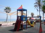 Estepona beach front, excellent clean beach running parralell to the town centre and kids play areas