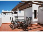 Spacious Roof Terrace - with table and chairs and views of surrounding areas