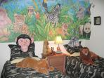 jungle themed room with twin beds