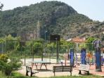 Fitness and games in the park. Zeytin Koru can be see on the right below the mountain, backdrop.