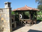 Shower, BBQ and outside shaded seating area at Zeytin Koru.