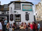 The Sloop Inn is a popular pub on the Harbour to people watch while having a pint of Rattler cider