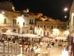 View of Ostuni main square and outdoor restaurants