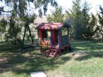 Children's playhouse, swings, seesaw