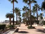 Enjoy a stroll by the Beach and Marina
