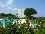 Pretty gardens, pool view and the development has carob trees dotted all around.