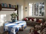 upstairs sunroom with books available in French and English