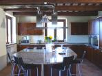 kitchen with large granite island as focal point