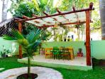 Patio veranda is equipped withy huge dining table