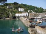 Polperro Harbour - Boat trips going out daily from the quayside.