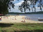 Beach at Lac de Vassiviere, with Cafes, Restaurants and Watersports.