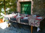 Dining under the grape arbor on the upper terrace