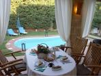 Breakfast by the private swimming pool in a green and cool garden