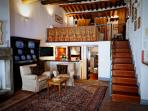 Main living room with soppalco (loft) master bedroom above