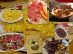 Ravioli al tartufo, spezzatino al sangiovese, grigliata mista, maialino in porchetta