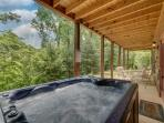 Enjoy the hot tub overlooking the mountains
