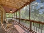 Screened in deck area with rocking chairs