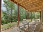 Outdoor patio on ground level located next to hot tub area.