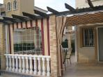 Patio with awnings closed while eating to keep the sun out