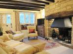 Warm, inviting living room with real fire