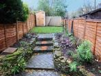 Private, enclosed garden with decking to the rear