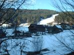 winter view of red piste run (from apartment)