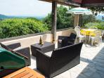 Relaxing sun terrace with BBQ and dining area