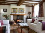 Willows` End inviting lounge with oak floors, beams and woodburner