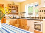 The well equipped kitchen can accommodate eight comfortably.