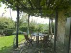 The terrace itself with canopy of vines and kiwi fruit for eating al fresco