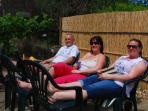 Julie, Kay & Simon (house owners) enjoying the sun in our garden by the rivulet