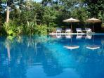 For you, a stunning infinity edge swimming pool and eight sun loungers shaded by large parasols
