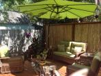 Relaxing outdoor deck and seating area with gas bbq grill.