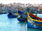 Marsaxlokk harbour with luzzus.